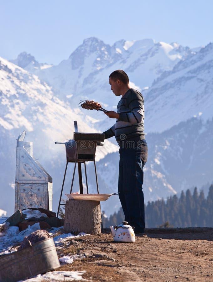 Kazakh man, in snow mountain royalty free stock image