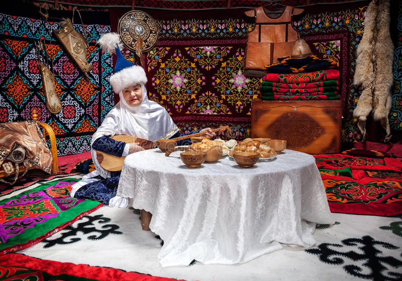 Kazakh women with dombra in the yurt editorial photo for Cuisine instrument