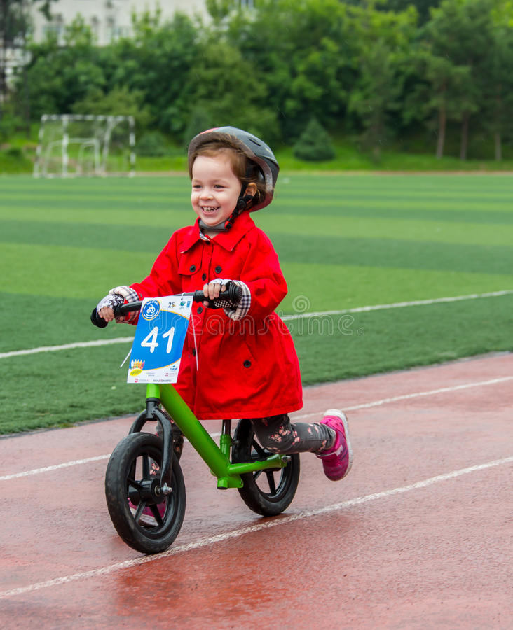 KAZAKHSTAN, ALMATY - JUNE 11, 2017: Children`s cycling competitions Tour de kids. Children aged 2 to 7 years compete in. The stadium and receive prizes. The royalty free stock image
