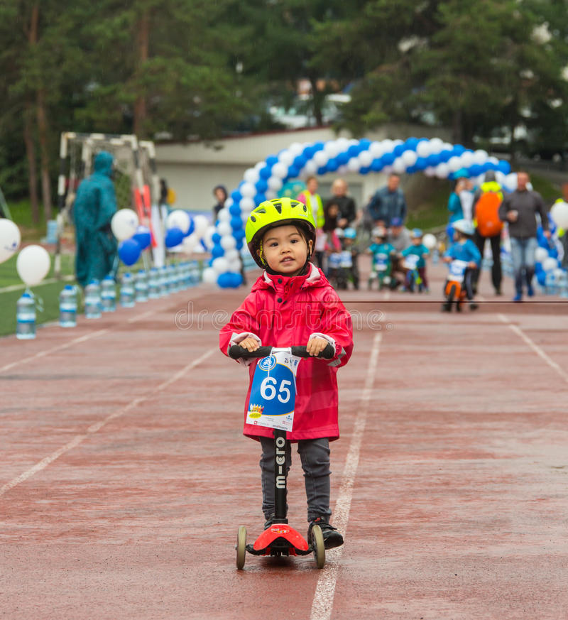 KAZAKHSTAN, ALMATY - JUNE 11, 2017: Children`s cycling competitions Tour de kids. Children aged 2 to 7 years compete in. The stadium and receive prizes. The royalty free stock photography