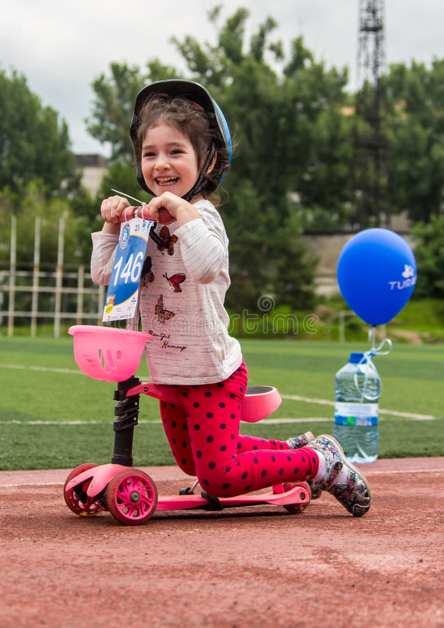 KAZAKHSTAN, ALMATY - JUNE 11, 2017: Children`s cycling competitions Tour de kids. Children aged 2 to 7 years compete in. The stadium and receive prizes. The royalty free stock photo