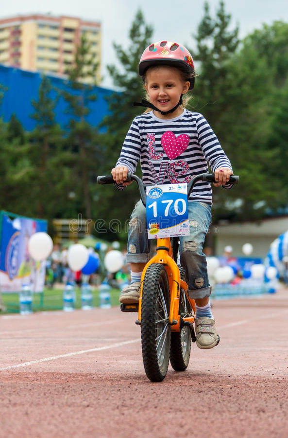 KAZAKHSTAN, ALMATY - JUNE 11, 2017: Children`s cycling competitions Tour de kids. Children aged 2 to 7 years compete in. The stadium and receive prizes. The stock images