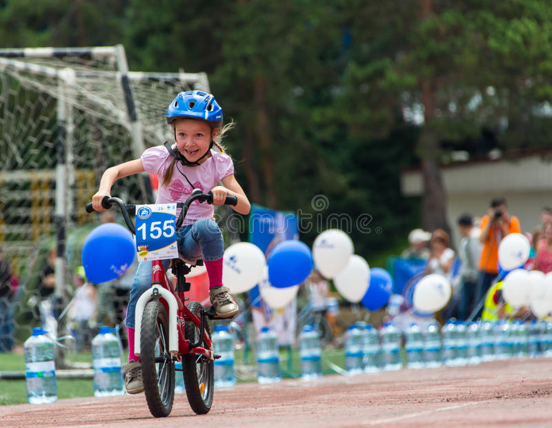 KAZAKHSTAN, ALMATY - JUNE 11, 2017: Children`s cycling competitions Tour de kids. Children aged 2 to 7 years compete in. The stadium and receive prizes. The stock image