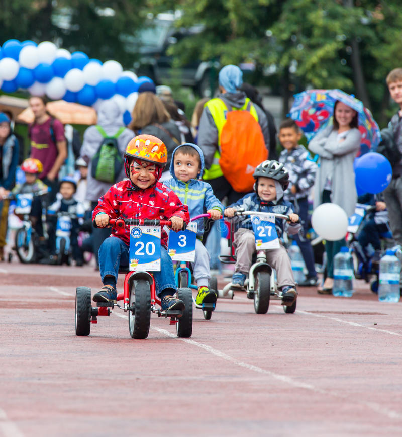 KAZAKHSTAN, ALMATY - JUNE 11, 2017: Children`s cycling competitions Tour de kids. Children aged 2 to 7 years compete in. The stadium and receive prizes royalty free stock photos