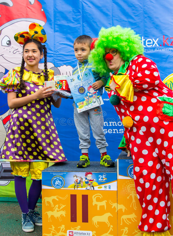 KAZAKHSTAN, ALMATY - JUNE 11, 2017: Children`s cycling competitions Tour de kids. Children aged 2 to 7 years compete in. The stadium and receive prizes. Little stock image