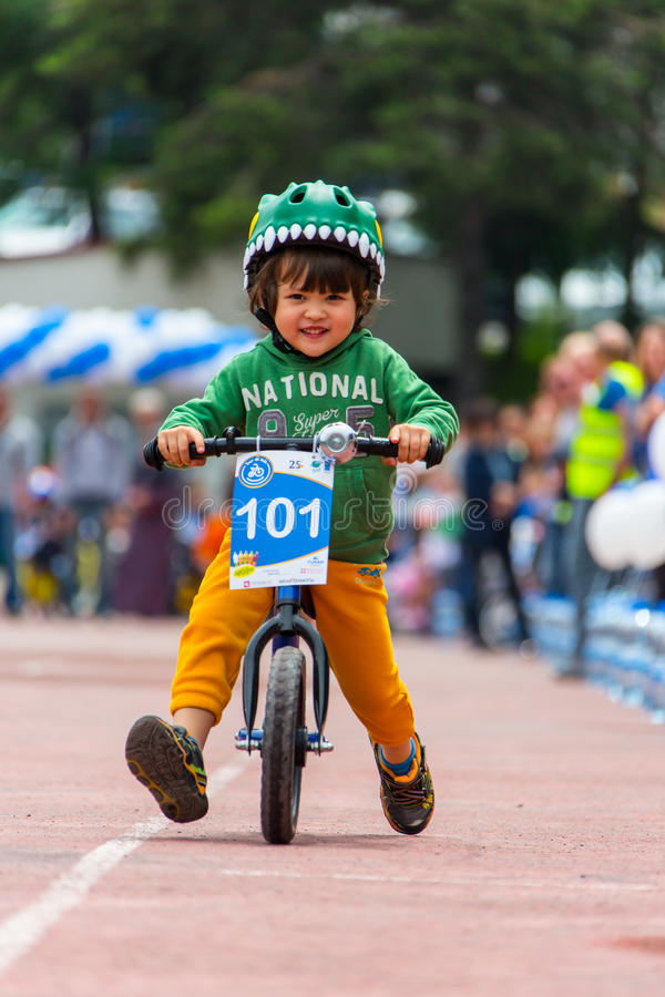 KAZAKHSTAN, ALMATY - JUNE 11, 2017: Children`s cycling competitions Tour de kids. Children aged 2 to 7 years compete in. The stadium and receive prizes. Little royalty free stock images