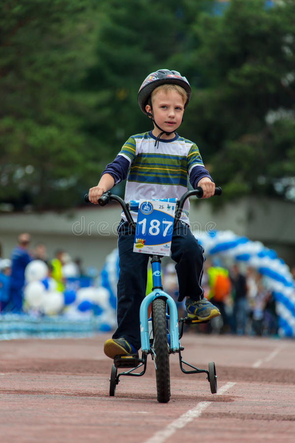 KAZAKHSTAN, ALMATY - JUNE 11, 2017: Children`s cycling competitions Tour de kids. Children aged 2 to 7 years compete in. The stadium and receive prizes stock image
