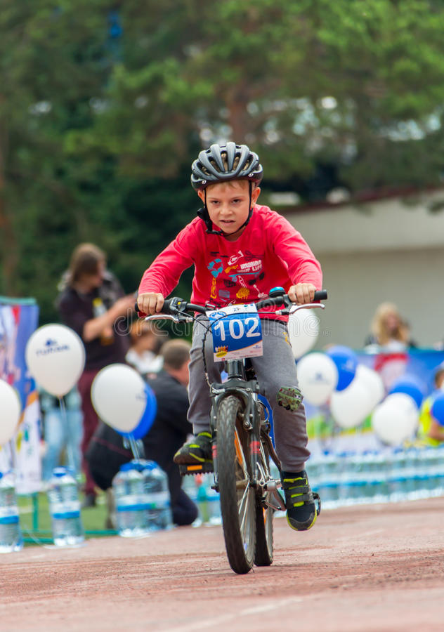 KAZAKHSTAN, ALMATY - JUNE 11, 2017: Children`s cycling competitions Tour de kids. Children aged 2 to 7 years compete in. The stadium and receive prizes stock photo