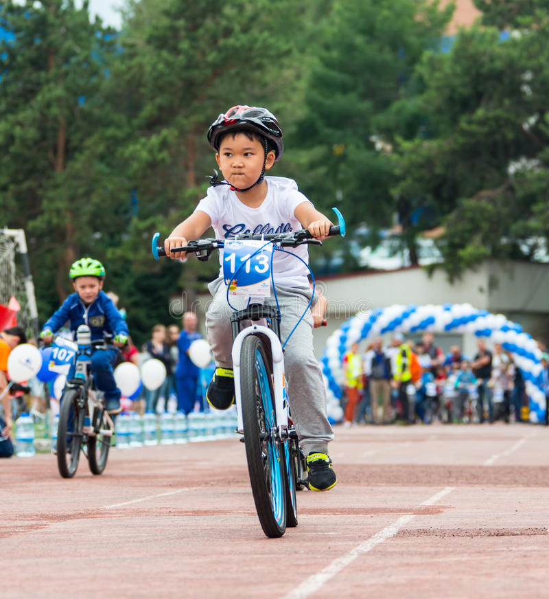 KAZAKHSTAN, ALMATY - JUNE 11, 2017: Children`s cycling competitions Tour de kids. Children aged 2 to 7 years compete in. The stadium and receive prizes royalty free stock images
