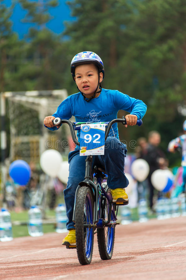 KAZAKHSTAN, ALMATY - JUNE 11, 2017: Children`s cycling competitions Tour de kids. Children aged 2 to 7 years compete in. The stadium and receive prizes royalty free stock photography