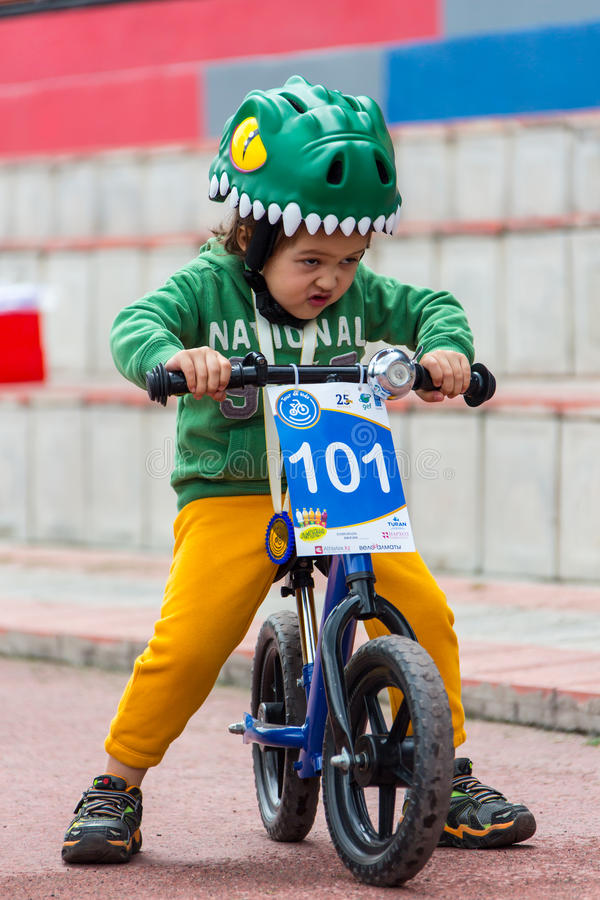 KAZAKHSTAN, ALMATY - JUNE 11, 2017: Children`s cycling competitions Tour de kids. Children aged 2 to 7 years compete in. The stadium and receive prizes. Little stock photo