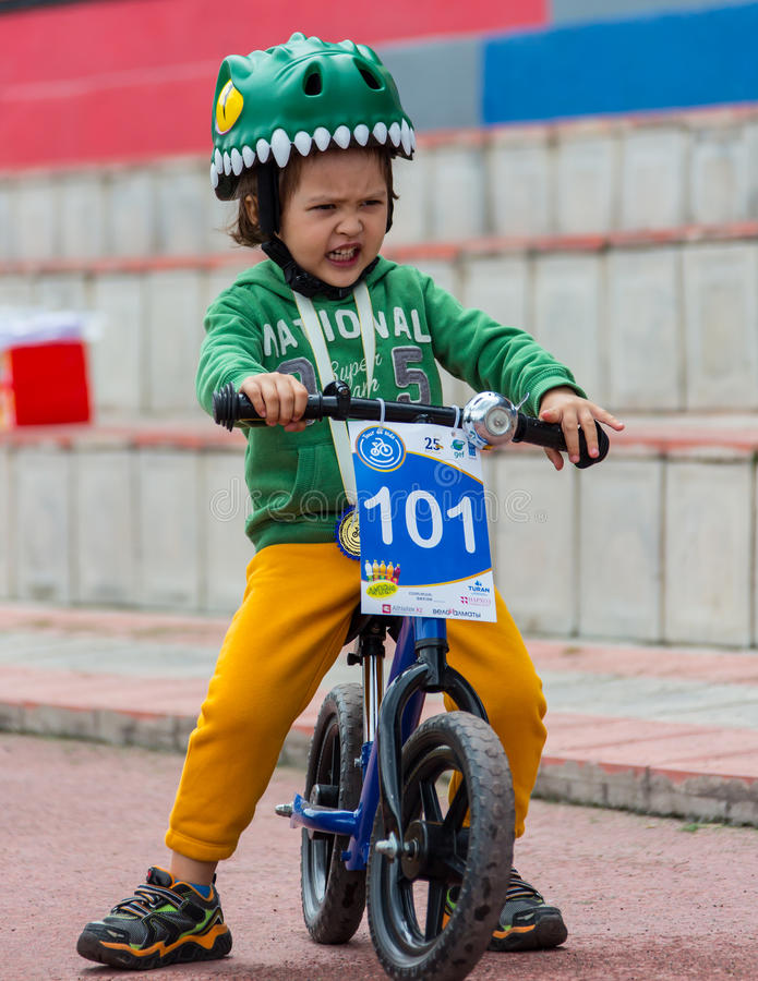 KAZAKHSTAN, ALMATY - JUNE 11, 2017: Children`s cycling competitions Tour de kids. Children aged 2 to 7 years compete in. The stadium and receive prizes. Little stock photos