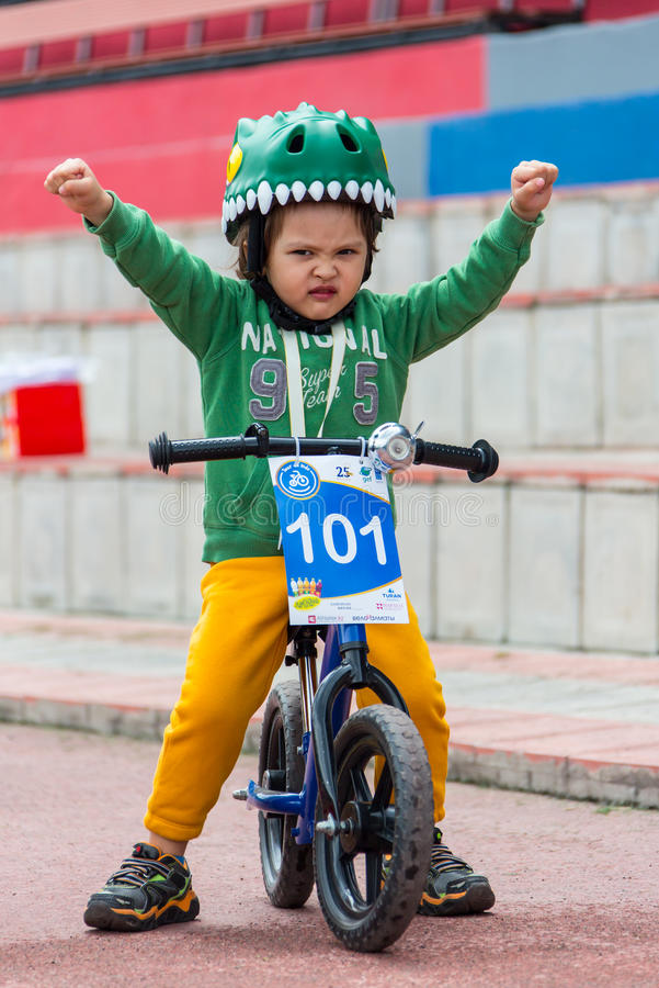 KAZAKHSTAN, ALMATY - JUNE 11, 2017: Children`s cycling competitions Tour de kids. Children aged 2 to 7 years compete in. The stadium and receive prizes. Little royalty free stock photography