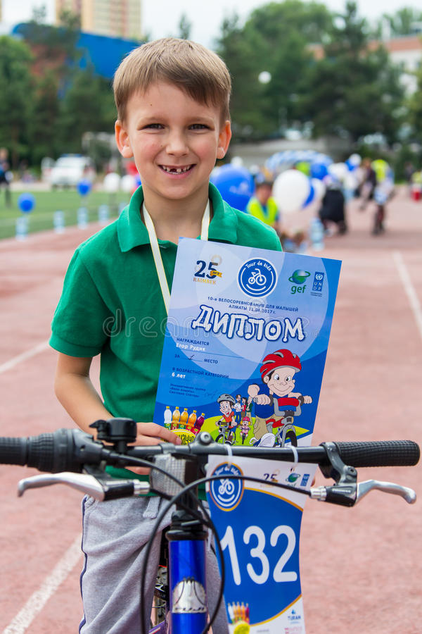 KAZAKHSTAN, ALMATY - JUNE 11, 2017: Children`s cycling competitions Tour de kids. Children aged 2 to 7 years compete in. The stadium and receive prizes. excited stock photo