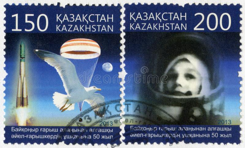 KAZAKHSTAN - 2013: devoted 50th anniversary of spaceflight of the first spacewoman from Baikonur spaceport. KAZAKHSTAN - CIRCA 2013: A stamp printed in royalty free stock image