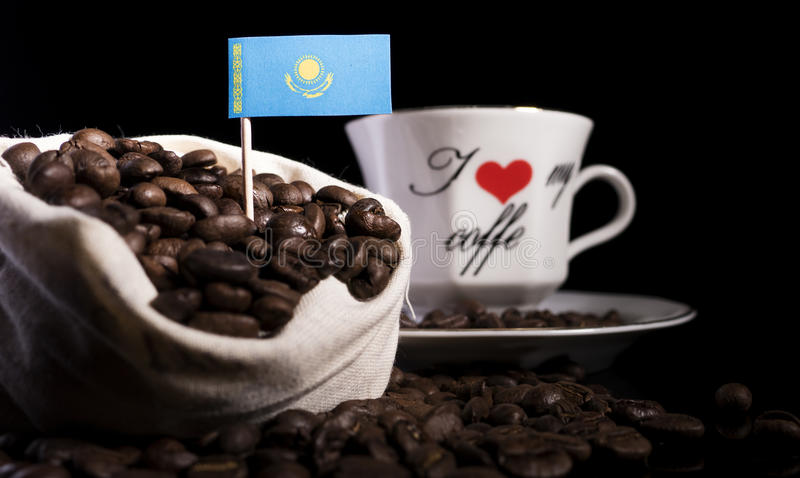 Kazakhstan flag in a bag with coffee beans on black stock photo