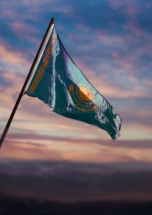 Kazakhstan flag, Kazakh flag waving on sky at dusk royalty free stock photo