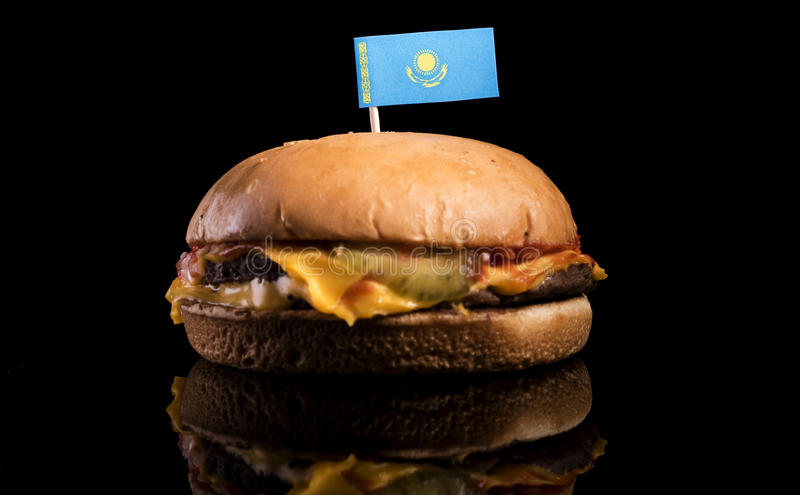 Kazakhstan flag on top of hamburger isolated on black stock image
