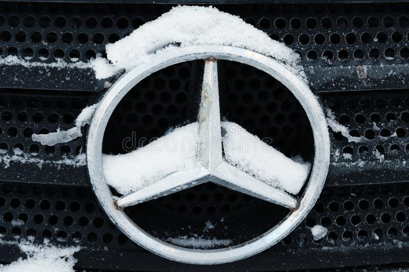 Kazakhstan, Kostanay, 2019-01-19. Mercedes iconic logotype covered with snow flakes. Winter. Close-up.Mercedes-Benz is automobile stock photography