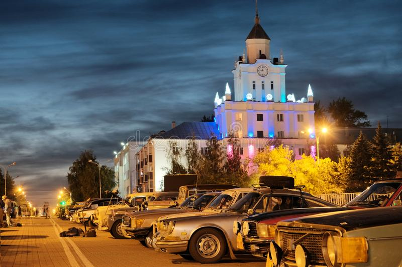 Kazakhstan, Kostanay, 19-06-19, Peking to Paris. Rally. Retro cars in the parking lot on the background of the city tower with a royalty free stock photos