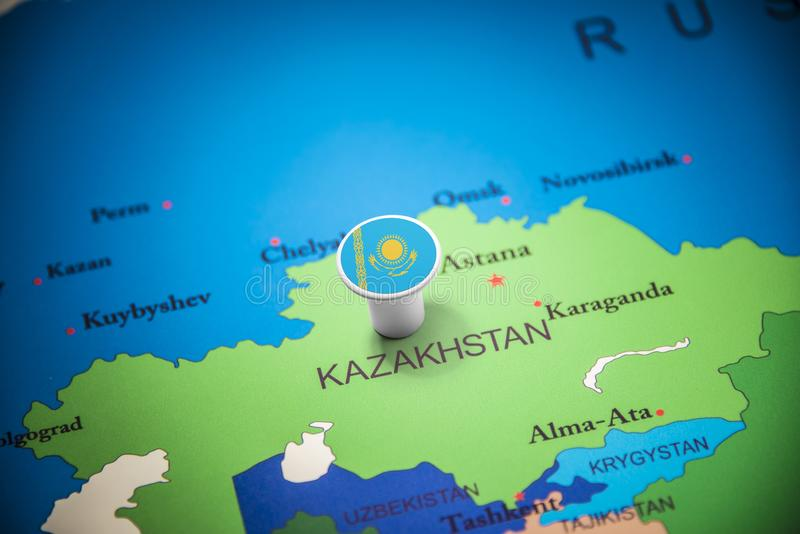 Kazakhstan marked with a flag on the map stock image