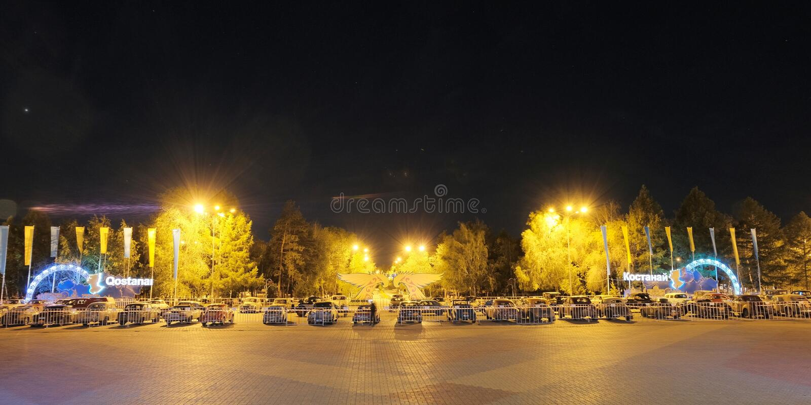 Kazakhstan, 19-06-19, Night. Night. Vintage cars in the town square. The inscription name of the city: Kostanay. Parking retro. Kazakhstan, Kostanay, 19-06-19 stock photography
