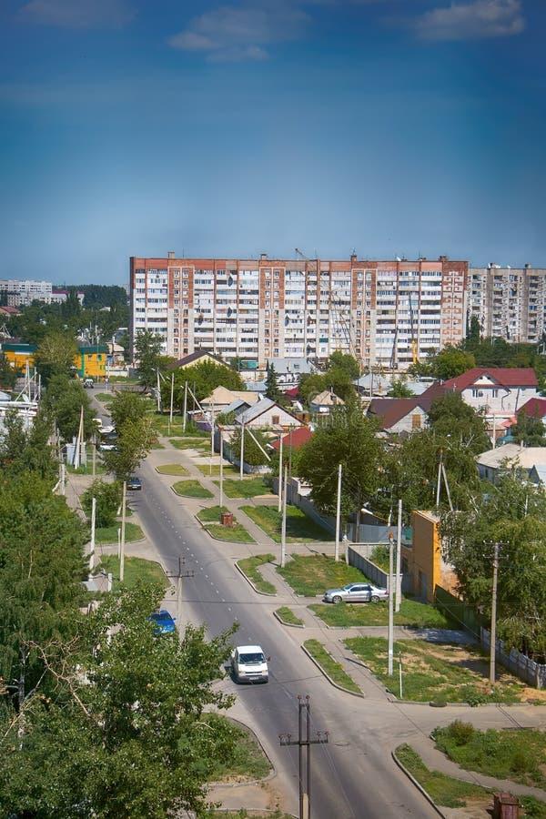 Kazakhstan, Pavlodar - July 24, 2016: City Pavlodar in Northern Kazakhstan 2016. Sector of private houses and apartment buildings. Quarter. Main area of stock image