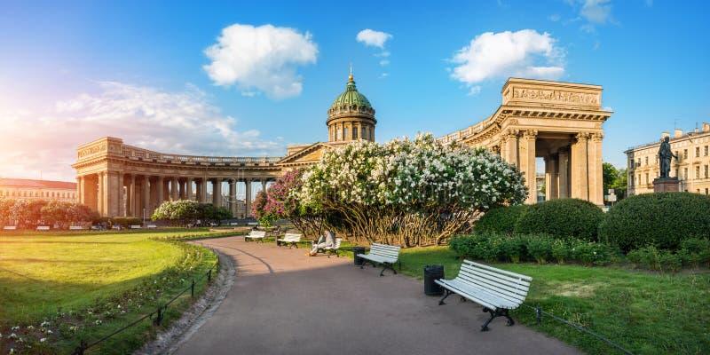 Kazan Cathedral and bushes of blossoming lilacs royalty free stock photo