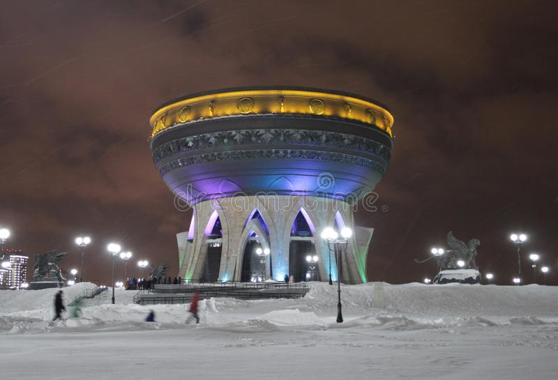 Kazan, Republic of Tatarstan, Russia - January 7, 2019: Family center and wedding palace `Kazan`. Night winter shot. Lot of snow on the ground and in the air royalty free stock images