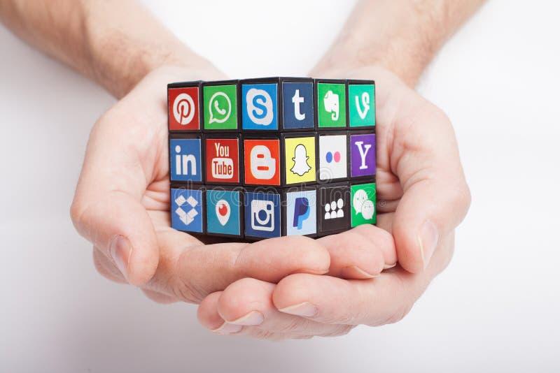 KAZAN, RUSSIA - January 27, 2018: Man`s hand holds a cube with social media logos stock photography