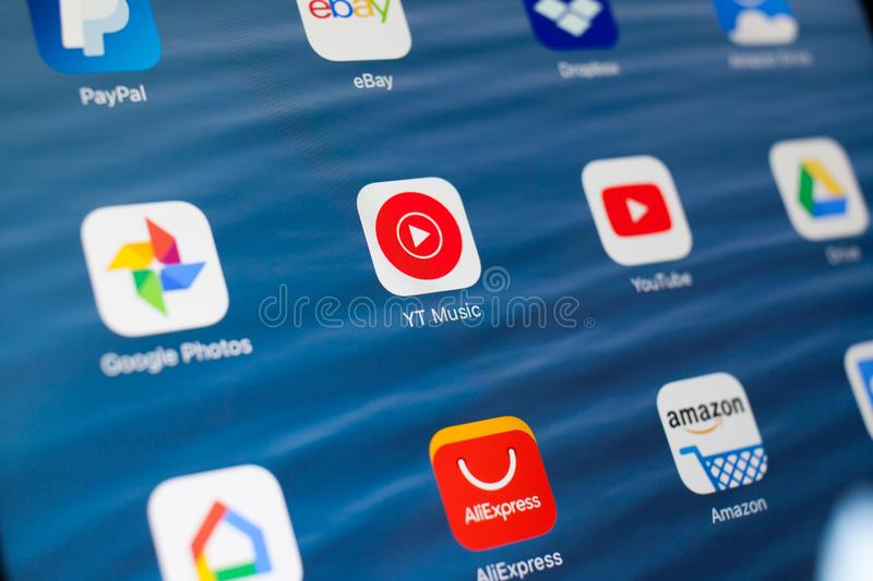 KAZAN, RUSSIA - JULY 3, 2018: Apple iPad with icons of social media. YT Music in center. KAZAN, RUSSIA - JULY 3, 2018: Apple iPad with icons of social media stock images