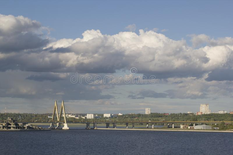 KAZAN, RUSSIA - JUNE 7, 2018: Views of the river and Millenium bridge in cloudy day stock photo