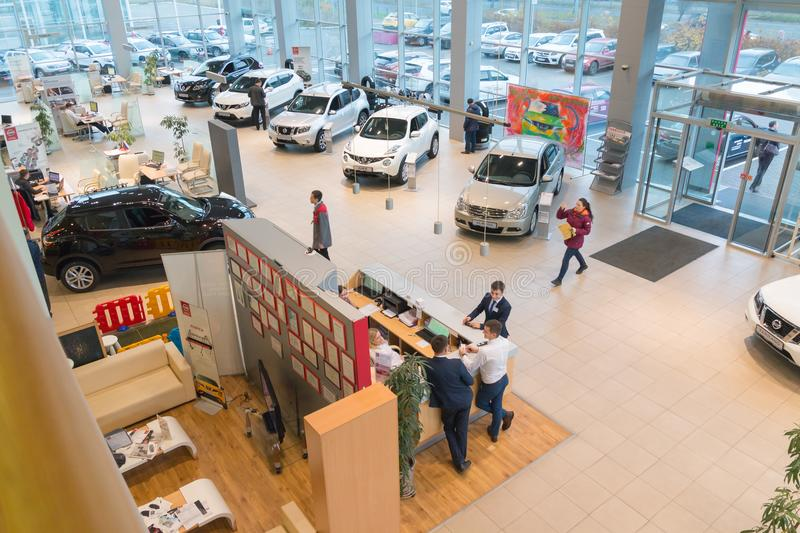 Car in showroom of dealership Nissan in Kazan city. View from the top. Kazan, Russia - October 19, 2017: Car in showroom of dealership Nissan in Kazan city. View royalty free stock images