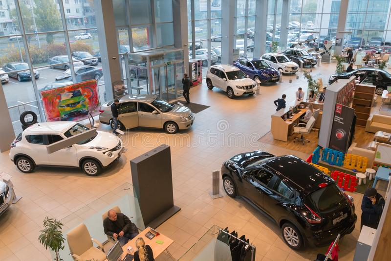 Car in showroom of dealership Nissan in Kazan city. View from the top. Kazan, Russia - October 19, 2017: Car in showroom of dealership Nissan in Kazan city. View royalty free stock photo