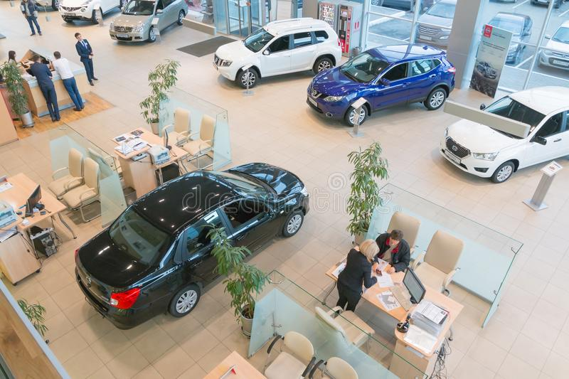 Car in showroom of dealership Nissan in Kazan city. View from the top. Kazan, Russia - October 19, 2017: Car in showroom of dealership Nissan in Kazan city. View stock images