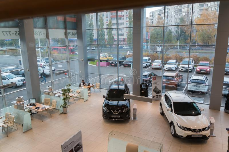 Car in showroom of dealership Nissan in Kazan city. View from the top. Kazan, Russia - October 19, 2017: Car in showroom of dealership Nissan in Kazan city. View royalty free stock photos