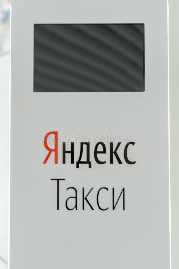 """Kazan, Tatarstan / Russia - May 10, 2019: multilingual terminal  self-service of online taxi booking service: """"Yandex Taxi"""". royalty free stock photography"""