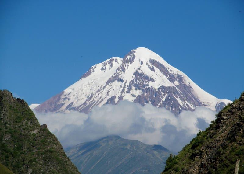 Kazbek mountain in Caucasian mountains, Georgia stock images