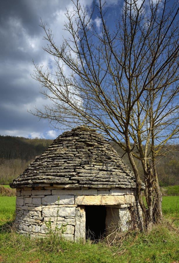 Kazun, un refugio tradicional de la mampostería seca imágenes de archivo libres de regalías