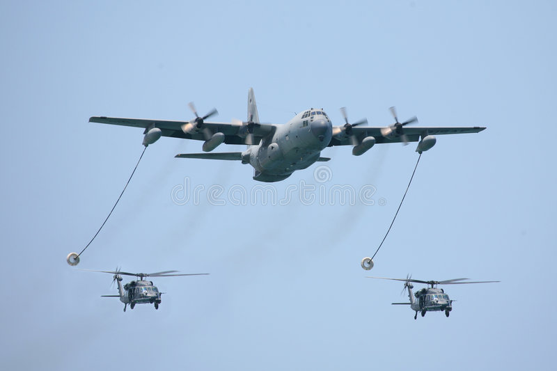 Download KC-130 Tactical Tanker With Two Helicopters Stock Image - Image: 4542521