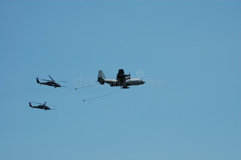 KC130 Tanker and Blackhawk helicopters for airshow stock photos