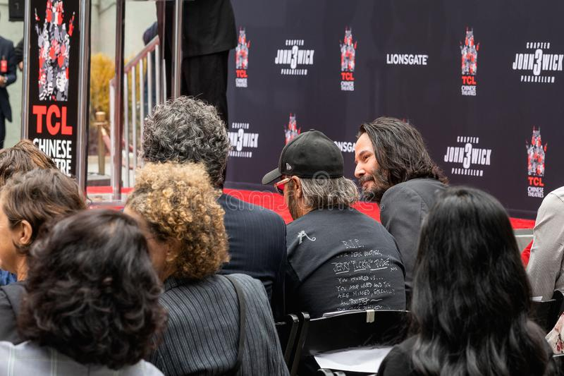 Keanu Reeves. Actor`s Handprints and Footprints Cemented on Hollywood Boulevard. Chinese Theater Event, Guests, Celebrities, Halle Berry, Laurence Fishburne royalty free stock photography