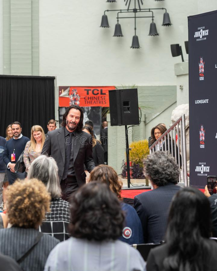 Keanu Reeves. Actor`s Handprints and Footprints Cemented on Hollywood Boulevard. Chinese Theater Event, Guests, Celebrities, Halle Berry, Laurence Fishburne royalty free stock images