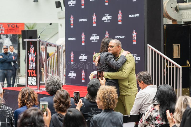 Keanu Reeves and Laurence Fishburne. Hollywood Blvd Event. Keanu Reeves. Actor`s Handprints and Footprints Cemented on Hollywood Boulevard. Chinese Theater Event royalty free stock photo