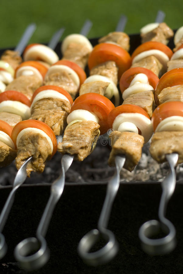 Kebab. Appetizing kebabs cooking on the BBQ at sunday royalty free stock photography