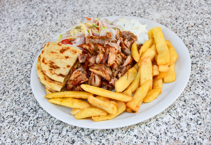 Greek gyros food plate royalty free stock photo