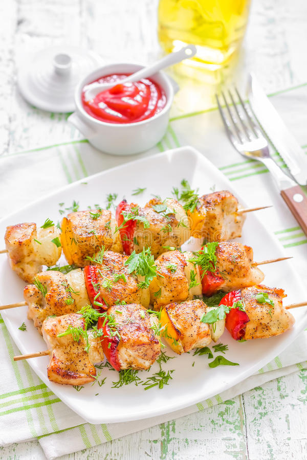 Kebab. Fresh grilled kebab with vegetables on a plate stock photography