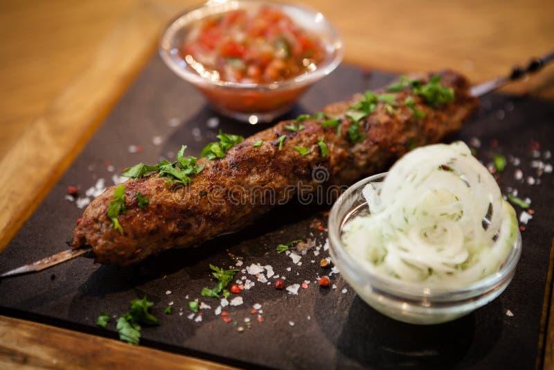 Kebab Lula с сальсой томата стоковая фотография