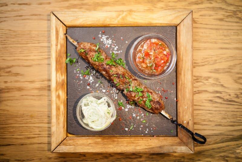 Kebab Lula с сальсой томата стоковые фотографии rf