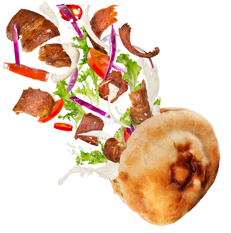 Kebab sandwich with flying ingredients. royalty free stock photos